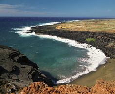 Papakolea Beach, known for its green sand. The beach's sand gets its beautiful green color from the mineral olivine, which was deposited on ...