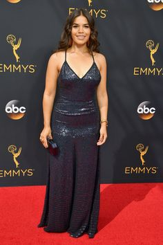 Get Your Fashion Fix Straight From the Emmys Red Carpet America Ferrera Wearing a shimmering black Jenny Packham gown with Neil Lane jewels, Kurt Geiger shoes, and a Jimmy Choo clutch.