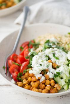 Mediterranean Yogurt Bowl, just like a falafal sandwich! Crispy chickpeas, tomatoes, mint, parsley, couscous, pickled onion and a tangy yogurt sauce. | delishknowledge.com