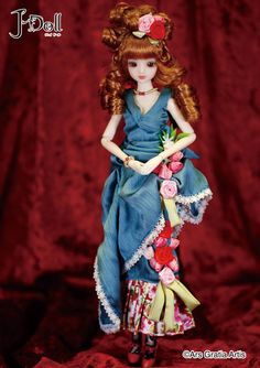 J-Doll Rua Garrett $95: Rua Garrett is a street in the center of the Portuguese capital Lisbon. Fernando Pessoa sat down to write and talk with friends at the Café A Brasileira.    - Shiny Royal Blue Dress use a subdued color of the adult.  - Floral motifs elegantly decorated on the dress are lovely.  - A voluminous vertical roll Hair Style