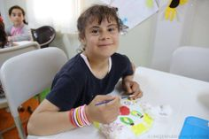 """On World Refugee Day, we'd like you to meet Nour, """"the girl named after the light in her eyes.""""   Nour fled her home in Syria because of violence and now lives in a refugee camp in Turkey. Although she misses her school for children with Down Syndrome, she loves to visit our Child Friendly Space - bringing smiles to everyone she meets. Read her heartwarming story here: http://www.unicef.ca/en/blog/nour-the-girl-named-after-the-light-in-her-eyes"""
