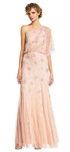 A Grecian style gown is alight with patterns of metallic beads and sequins, finished with wispy godets.