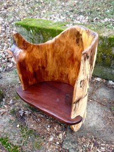 """log chair with arm rest""""  $1200"""