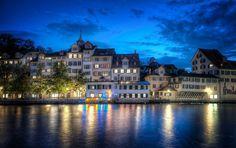 Strange, light, reflective top of heavy, deep, and dark waters. Zurich, Switzerland at night. Stuck in Customs