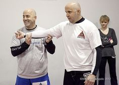 Instructors Bill Kline, of the Absecon Highlands section of Galloway Township, right, and Rich Komar, of Dorothy, who owns Komar Jiu Jitsu, teach a blocking technique to use against an attacker, during an easy escape women's self defense class on Mon self defense training