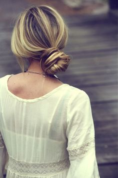 Another great alternative to the messy bun isthis chic little number. Rather than pulling your hair straight back, keep your natural part, or even part it further to one side, and pull your hair back. Create a messy bun (this tutorialmight help!) slightly off to the side. Pull a few pieces out in front to keep that casual vibe. via @stylelist