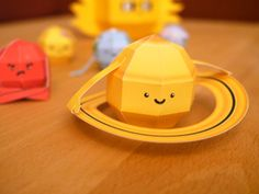 Papercraft: Solar system - all eight planets, Pluto, and the Sun. Free PDF templates.