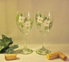 Dogwood blossoms hand painted on wine glasses set by DeannaBakale