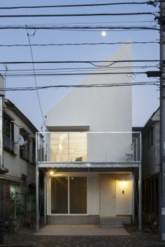 GEH House is a minimalist house designed by I.R.A.. in which enough sunlight would enter the interior. By placing the main bedroom and the water closet on the first floor, the architects were able to maximize the volume for the living and kitchen space on the second floor within the setback regulation from site boundary. http://leibal.com/architecture/geh-house/