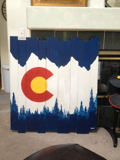 These are custom, hand painted, wood pieces that we make and sell. Mountain and tree Colorado flag design. Email designs.grain@gmail.com for more information and pricing. Flag, mountains, co, Colorado, art, paint, pallet, wood, craft, custom