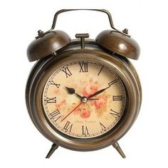 This listing is for a Shabby Chic vintage style bed side alarm clock in a bronzed metal look with roman numerals and a rose pattern on the clock face. Bed Styling, Roman Numerals, Shabby Chic Homes, Alarm Clock, Vintage Fashion, Vintage Style, Retro, Clocks, Decoration