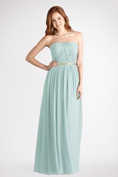 A thin  Gold belt accents this strapless long beach glass chiffon  gown with a  crisscross  ruched bodice and  flowy skirt.