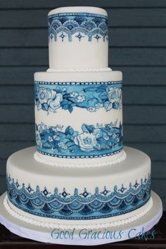 Exquisite!!!   Blue and White hand painted cake - the technique is cocoa painting. Melted cocoa butter mixed with powdered food color.