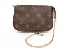 Louis Vuitton Monogram Accessories Chain Pouch Pochette Shoulder Bag. Get one of the hottest styles of the season! The Louis Vuitton Monogram Accessories Chain Pouch Pochette Shoulder Bag is a top 10 member favorite on Tradesy. Save on yours before they're sold out!