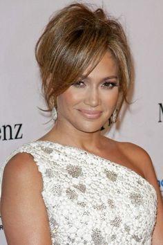 Jennifer Lopezs brunette, updo hairstyle