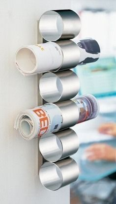 Not enough space on your bedside table?  Mount some up-cycled tin cans on your wall to hold magazines or newspapers.  Great idea for the bathroom, too!