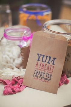 personalized favor bags for treats with the couple's color scheme // photo by OrangeTurtlePhotography.com