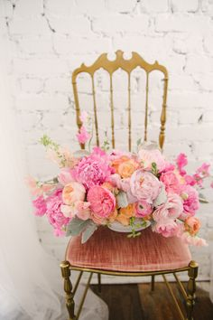 Pretty pink blooms on a pink velvet chair