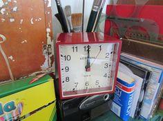 "Red Cubic Alarm Clock ** SURPRISE SALE ITEM** Darling red clock! Vintage looking glossy red cube shaped acrylic alarm clock with acrylic lens. 4"" x 4"" x 3 3/4"". SALE PRICE $65.00 (REGULAR PRICE: $79.95)"