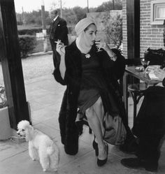 bunnydell:    Elizabeth Taylor sipping Champagne, smoking a cigarette while wearing a turban next to a poodle.  Is there anything more you could ask for?