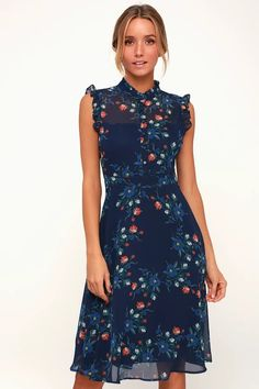 274255e4cd5 Spend sunny days sippin  lemonade in the Lulus Porch Swing Navy Blue Floral  Print Midi Dress! Floral print midi dress with ruffles and a covered button  ...