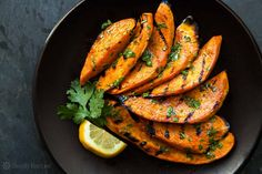 Slices of sweet potatoes grilled and slathered with a cilantro-lime dressing.