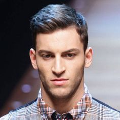 Men's hair with a side part.
