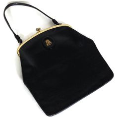 Vintage Saks Fifth Avenue black leather bag with a top handle Evening bag with a fabric interior and one inside pocket Gold tone metal top