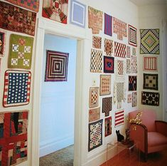Small quilts covering the walls