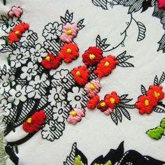 Stitching flowers on fabric