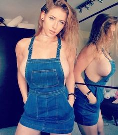 Half naked girl in overalls assured