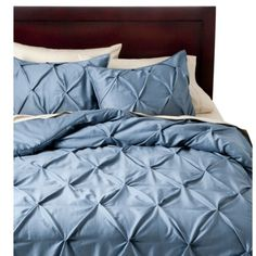Modern and luxurious, Threshold's Pinched Pleat Comforter Set makes an elegant addition to any