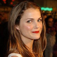 beautiful red lips and sleek hair...sometimes red lips can look sloppy, but Keri does a great job keeping it neat.