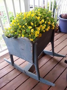an old cradle used as a planter, nice container