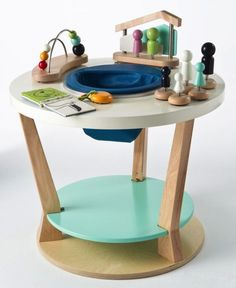 OMG.  Avoiding the colorful plastic conundrum... this wooden exersaucer is AMAZING.  And also the same cost as my mortgage every month.  Maybe worth it?  The Bobbin from Three Pears « buymodernbaby.com