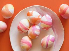 watercolor eggs   The key to making watercolor eggs that don't look messy is choosing a few colors in a similar color scheme. (via Spoon Fork Bacon)