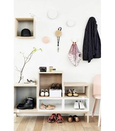 @Who What Wear - Everything In Its Place If you tend to rotate between a few pairs of shoes, keep them in an open bookcase display by the door, so you can quickly grab them on your way out.  Tip: Avoid clutter by assigning a maximum of two pairs to each cubbyhole.