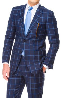 Classic blue windowpane suit white shirt and light blue tie