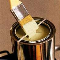 Place a rubber band around an open paint can to wipe your brush on, and keep paint off the side of the can
