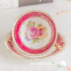 Stunning ruby red Stanley cabinet teacup and by TheButteredCat