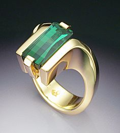 How gorgeous is this? A modern setting for a rectangle green tourmaline. I'd love this in white gold. from tias.com