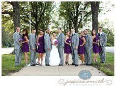 grey suits, purple dresses. side note : this pic is akward, I cant tell who is the groom? maybe groom with have purple vest and others grey vest?