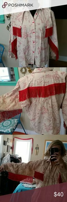 VTG Roper Western Rodeo ButtonDown Fringed Top!♡ Wow! This is amazing. VTG Roper Western top, matching lil red buttons down front, on wrists and on chest. Has this amazing red fringe underarms, around collar and in back. 100% cotton with shoulder pads. Fits like a M/L. Has western design all over top. Cream/tan colored and red. Super funky. I'd think a woman wore this during a rodeo in the 70s or 80s. I love the history of this top!♡ Vintage Tops Button Down Shirts