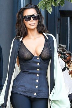 Eye catching: The mother of two made an impression with her sheer bustier