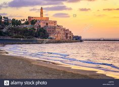 Old town of Jaffa over the sand beach bay on sunset, Tel Aviv, Israel Stock Photo - Alamy Sand Beach, Tel Aviv, Old Town, Monument Valley, Israel, Taj Mahal, Stock Photos, Sunset, Building
