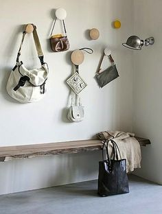 """Muuto's set of five individually sized """"hooks"""", or dots, enables you to set your own storage configuration while adding a little decorative whimsy. from Scandinavian Grace."""