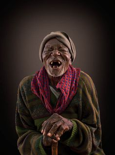 Africa - old Himba man laughing.