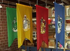 Harry Potter Party: Crests painted on paiper & glued to plastic tableclothes  The Ultimate Guide to Recreating the Magic of Hogwarts
