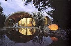 amphitheater meets 1960's mod home? I just love the pond reflection :)