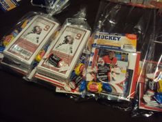 Hockey lootbags contained: 1 pkg of junior mints (with a hockey cover), 1 hockey themed pencil, 1 pkg hockey cards, hockey stickers/tattoos, a hockey puck with their name on it, and candy.